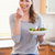 young woman eating some salad in the kitchen stock photo © wavebreak_media