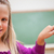 close up of a schoolgirl pointing at a country on a globe stock photo © wavebreak_media