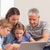 счастливая · семья · сидят · диван · используя · ноутбук · гостиной · семьи - Сток-фото © wavebreak_media