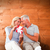 composite image of happy couple sitting and holding present stock photo © wavebreak_media