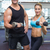 bodybuilding man and woman holding dumbbells smiling at camera stock photo © wavebreak_media