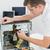 fiatal · technikus · dolgozik · törött · számítógép · iroda - stock fotó © wavebreak_media