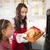 Surprised mother and daughter with roast turkey stock photo © wavebreak_media