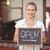 smiling waitress showing chalkboard with open sign stock photo © wavebreak_media
