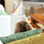 kobieta · czytania · domu · książki · fotel · stóp - zdjęcia stock © wavebreak_media