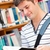 Cute male student reading a book in a bookstore stock photo © wavebreak_media