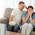 Terrified couple watching a horror movie at home stock photo © wavebreak_media
