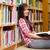 cute female student holding a book in a library stock photo © wavebreak_media