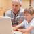 мальчика · отец · используя · ноутбук · кухне · интернет · ноутбука - Сток-фото © wavebreak_media