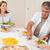 aile · başlatmak · akşam · yemeği · birlikte · gülümseme · erkek - stok fotoğraf © wavebreak_media