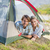 attractive couple smiling at camera from inside their tent stock photo © wavebreak_media