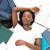 ernstig · student · huiswerk · bed · home · vrouw - stockfoto © wavebreak_media