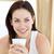 glimlachende · vrouw · drinken · beker · koffie · slaapkamer · ochtend - stockfoto © wavebreak_media