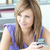 Delighted woman using a phone in the kitchen stock photo © wavebreak_media