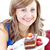 smiling woman holding a piece of chocolate cake stock photo © wavebreak_media