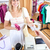 Caucasian woman is paying items in a clothes shop stock photo © wavebreak_media