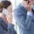 boldog · üzletasszony · okostelefon · kollégák · nő · internet - stock fotó © wavebreak_media