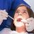 tandartsen · onderzoeken · vrouwelijke · patiënt · tandheelkundige · licht - stockfoto © wavebreak_media