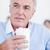 senior businessman holding a drinking cup stock photo © wavebreak_media