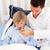Handsome father checking his son's temperature stock photo © wavebreak_media
