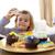 felice · bambina · mangiare · confetteria · home · colorato - foto d'archivio © wavebreak_media