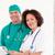 cirujano · enfermera · sonriendo · cámara · hospital · mujer - foto stock © wavebreak_media