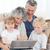 adorável · família · olhando · laptop · casa · mulher - foto stock © wavebreak_media