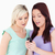 Portrait of young women with a cellphone in a studio stock photo © wavebreak_media
