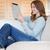 uśmiechnięty · młoda · kobieta · kanapie · tabletka · komputera · Internetu - zdjęcia stock © wavebreak_media
