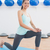 sporty young woman stretching leg in fitness studio stock photo © wavebreak_media