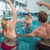 fitness class doing aqua aerobics on exercise bikes stock photo © wavebreak_media