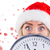 composite image of festive blonde showing a clock stock fotó © wavebreak_media