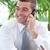 Businessman sitting on sofa and talking on phone stock photo © wavebreak_media