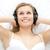 piękna · kobieta · słuchanie · muzyki · bed · kobieta · muzyki · domu - zdjęcia stock © wavebreak_media