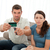 Worried couple cutting their credit card together sitting on the sofa at home stock photo © wavebreak_media