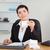Serious office worker doing accountancy in her office stock photo © wavebreak_media