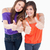 Teenagers putting their thumbs up with beaming smiles stock photo © wavebreak_media