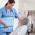 hemşire · ayakta · hasta · tekerlekli · sandalye · hastane · kadın - stok fotoğraf © wavebreak_media