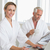 couple shopping online and reading newspaper in bathrobes stock photo © wavebreak_media