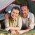 outdoorsy couple smiling at camera from inside their tent stock photo © wavebreak_media