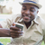 smiling man relaxing in his garden texting on phone stock photo © wavebreak_media