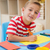 glimlachend · weinig · jongen · tekening · familie · school - stockfoto © wavebreak_media