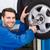 meccanico · pneumatico · ruota · riparazione · garage · servizio - foto d'archivio © wavebreak_media