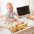 feliz · madre · bebé · usando · la · computadora · portátil · alfombra · salón - foto stock © wavebreak_media