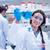 mosolyog · férfi · tudós · laborköpeny · tart · molekuláris - stock fotó © wavebreak_media