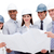 International architects holding a blueprint stock photo © wavebreak_media