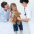 a doctor examining smiling child and playing with a teddy bear stock photo © wavebreak_media