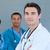 fiatal · férfi · orvos · csapat · néz · kamera · munka - stock fotó © wavebreak_media