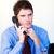 grave · imprenditore · parlando · telefono · ufficio · sorriso - foto d'archivio © wavebreak_media