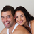 smiling romantic couple relaxing in each others company stock photo © wavebreak_media